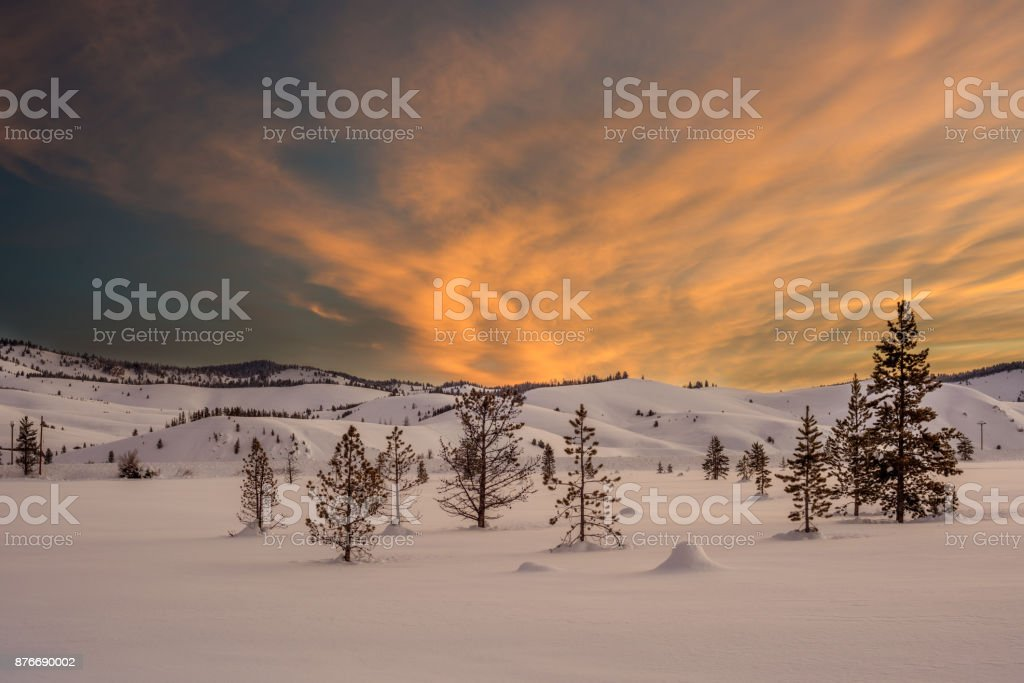Dramatic clouds with warm colors of a winter surise stock photo