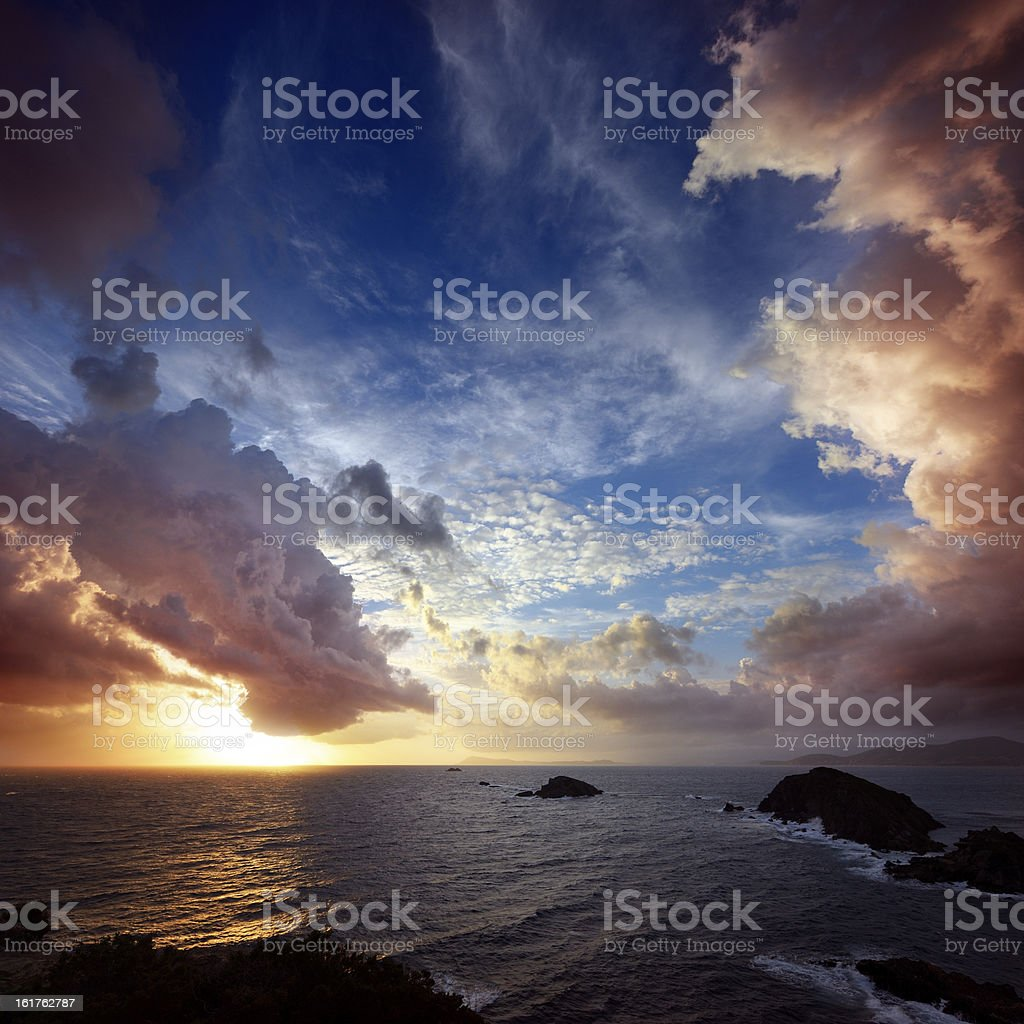 Dramatic Cloudscape over Rocky Coastline at the Cote D'Azur royalty-free stock photo