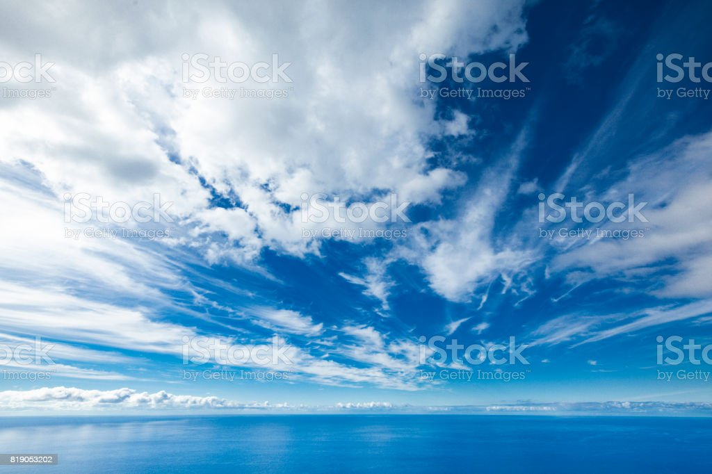 dramatic cloudscape over water horizon stock photo