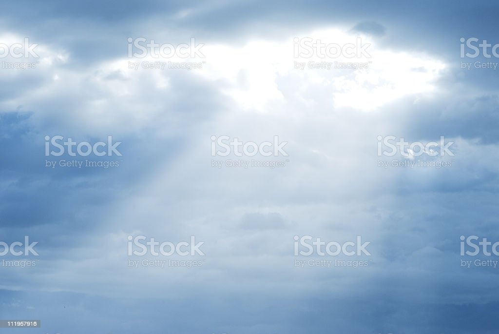 Dramatic cloudscape with sunrays coming through clouds royalty-free stock photo