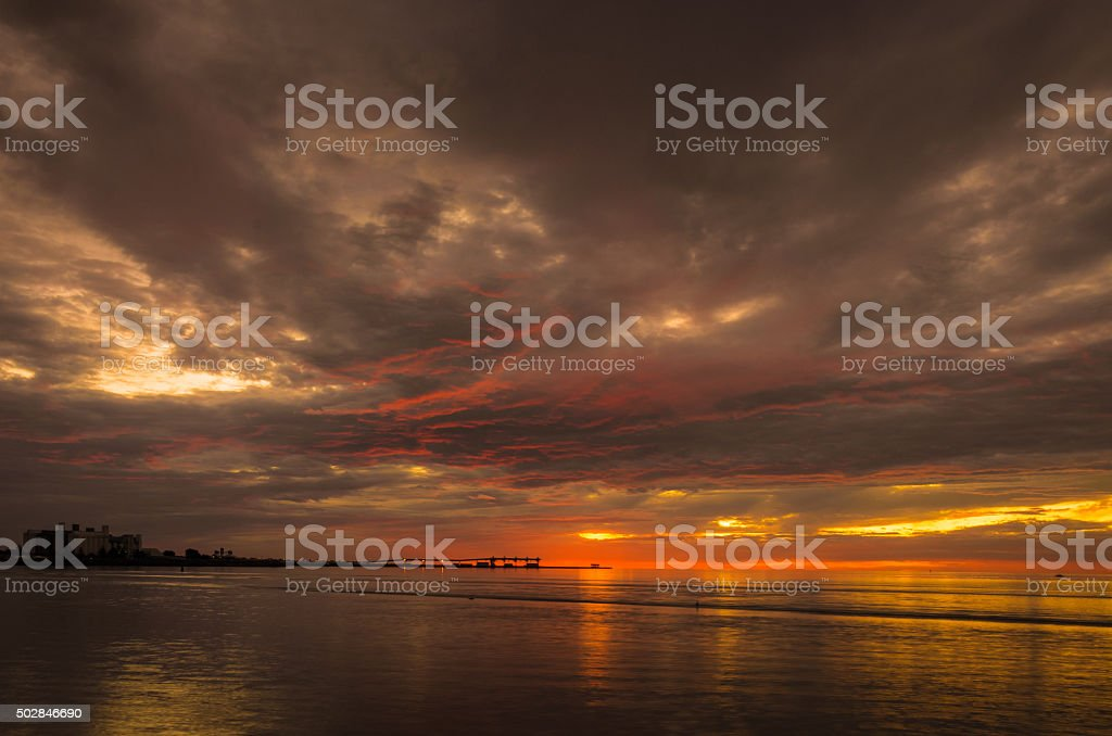 Dramatic cloudy landscape at the beach stock photo