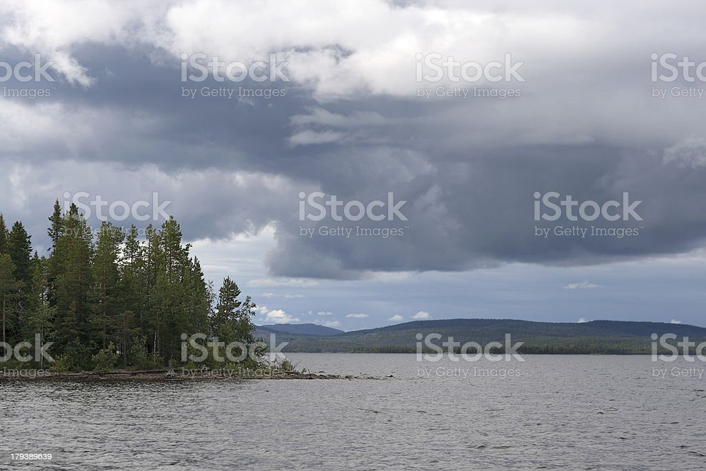 Dramatic cloudy sky above lake royalty-free stock photo