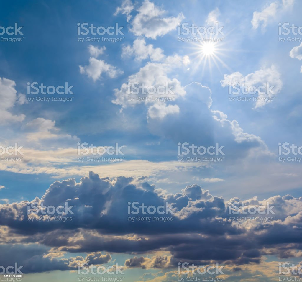 dramatic cloudy sky with sparkle sun royalty-free stock photo