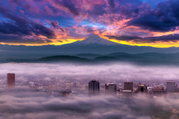Dramatic colorful sunrise over Mount Hood and foggy Portland Oregon city downtown Dramatic colorful sunrise over Mount Hood and foggy Portland Oregon city downtown mt hood stock pictures, royalty-free photos & images