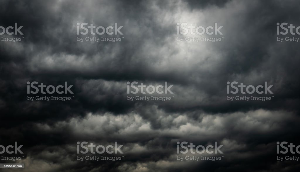 Dramatic dark sky and clouds. Cloudy sky background. Black sky before thunder storm and rain. Background for death,  sad, grieving or depression. zbiór zdjęć royalty-free