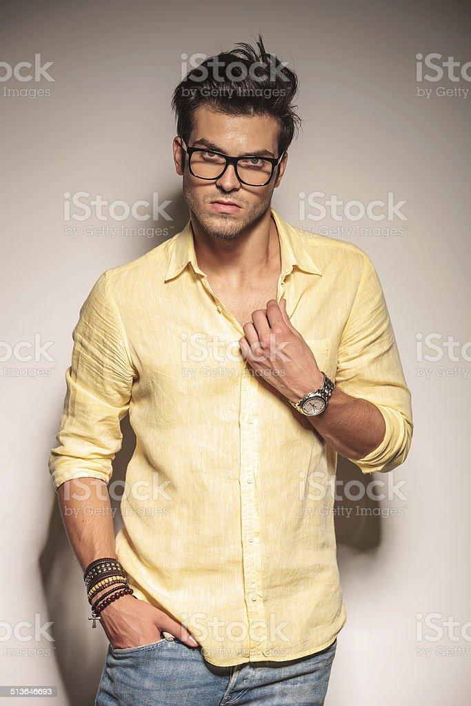 dramatic fashion male model holding his collar stock photo