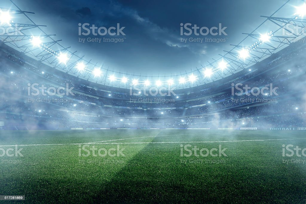 Dramatic football stadium with fog stock photo