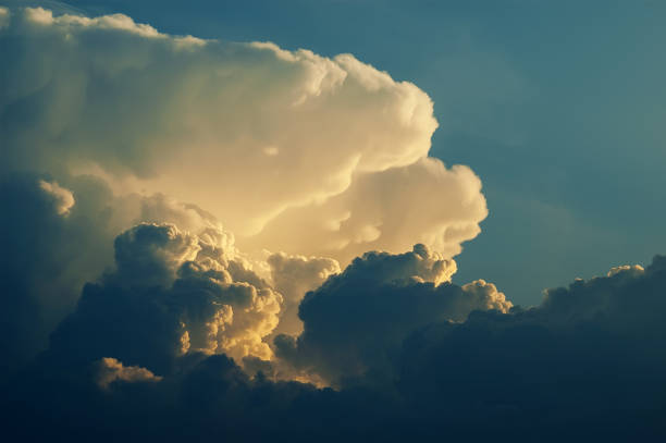 Dramatic formation of cumulonimbus clouds rising in blue sky Dramatic formation of thunderstorm towering cumulonimbus clouds rising in blue sky, Cumulus congestus anvil stock pictures, royalty-free photos & images