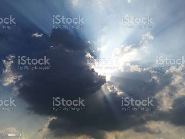 Photo of Dramatic god lights passing through clouds and shining on shining on sky.