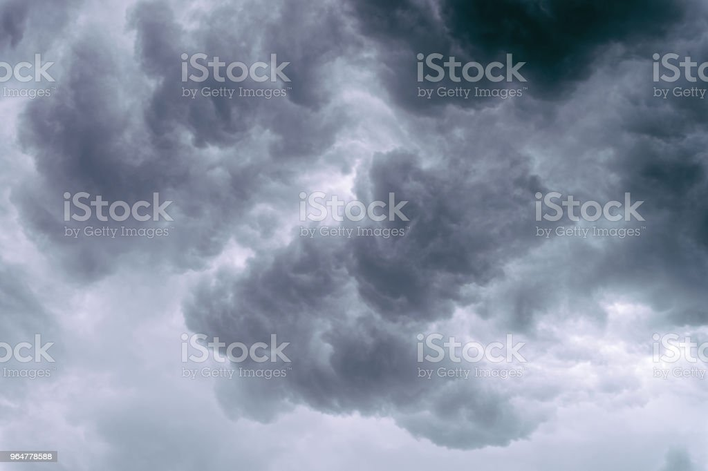 Dramatic grey clouds in the sky before heavy storm royalty-free stock photo