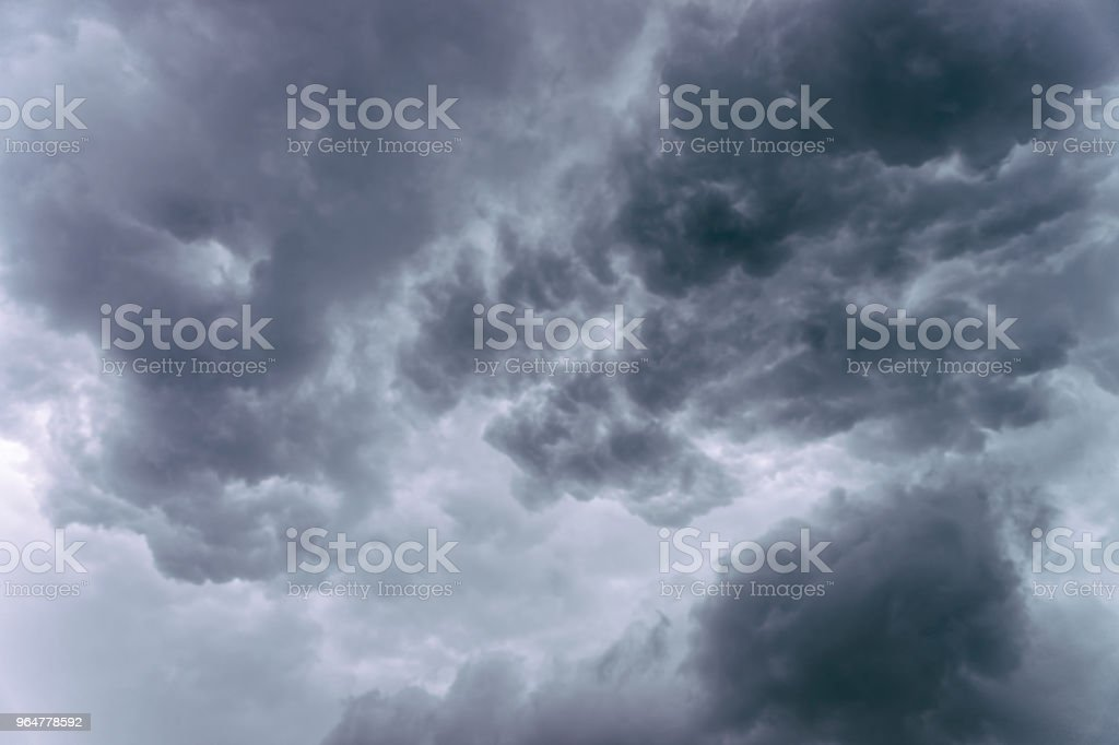 Dramatic grey clouds in the sky before the heavy rain royalty-free stock photo