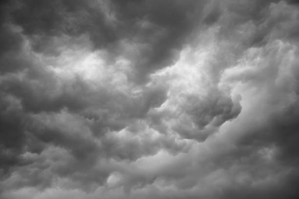 dramatic grey clouds stock photo
