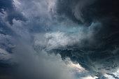 Intense cumulonimbus clouds formation - updraft rotation of hailstorm viewed under near Duino (Italy).