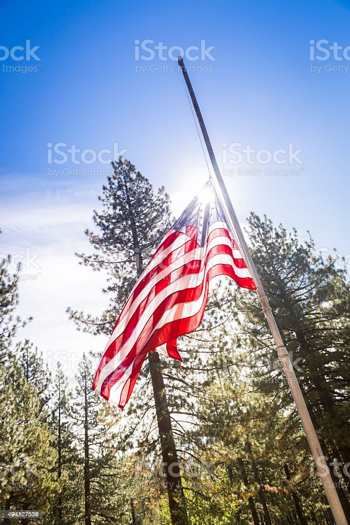 Dramatic Half Mast American Flag stock photo