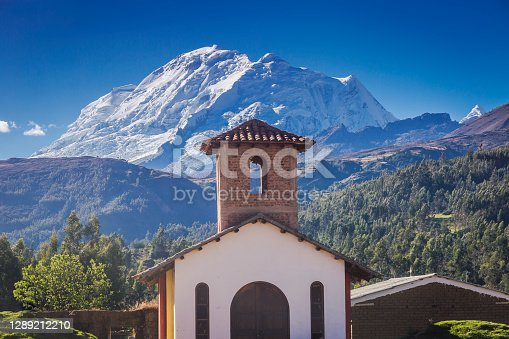 Dramatic Huascaran Mountain peak and colonial Church - Cordillera Blanca - Ancash Andes, Peru