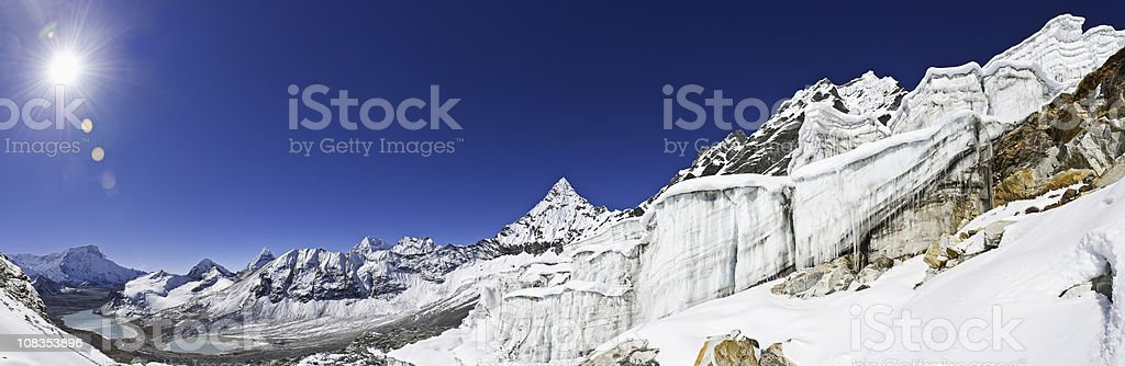 Dramatic ice cascade sunburst massive icicles glacier seracs Himalayas Nepal royalty-free stock photo