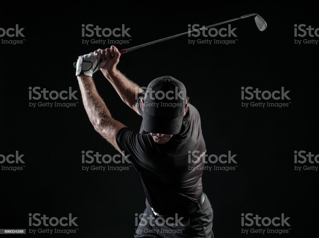 Dramatic Image Of A Male Golfer At The Top Of His Swing stock photo