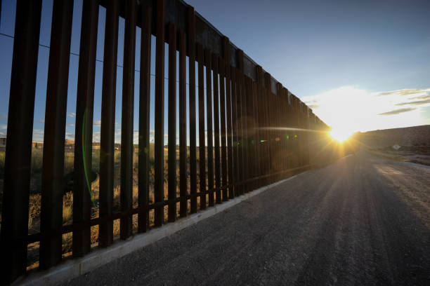 Dramatic Image of the US/Mexico Border Wall at Port Anapra Near El Paso Texas Dramatic Image of the US/Mexico Border Wall at Port Anapra Near El Paso Texas international border barrier stock pictures, royalty-free photos & images