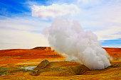 Dramatic Landscape: Geysers de La manana (Morning geysers) sulphur craters fumes at sunrise and Idyllic Atacama Desert puna exoticism, snowcapped Volcanic landscape panorama – Potosi Region, Bolivian Andes, Chile, Bolívia and Argentina border