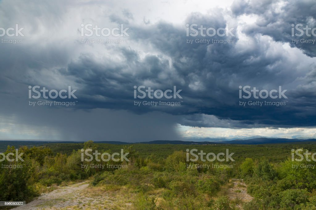 Panoramic shot of a heavy storm rain approaching Karst, Slovenia