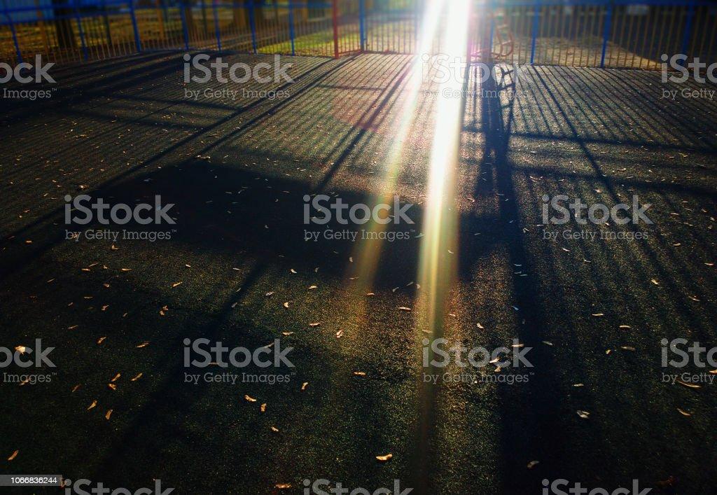 Dramatic light rays on sport playground background stock photo