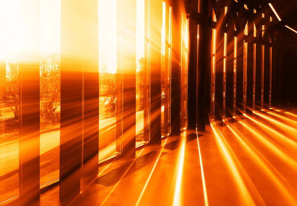 Dramatic light rays though vetical columns background stock photo