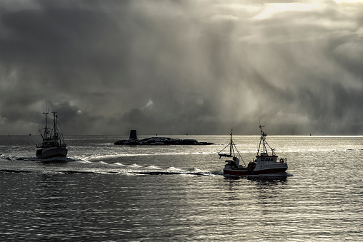 Dramatic light with two fishing boats