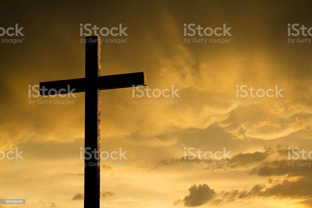 Dramatic Lighting on Christian Cross As Storm Clouds Break stock photo