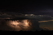 A lightning storm over the Great Plains provides a dramatic light show at night