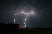 Several lightning bolts are striking into the foothills of the Carpathian mountains in Romania.