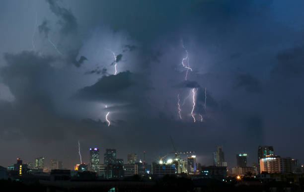dramatic lightning strike in bangkok, thailand - lightning stock photos and pictures