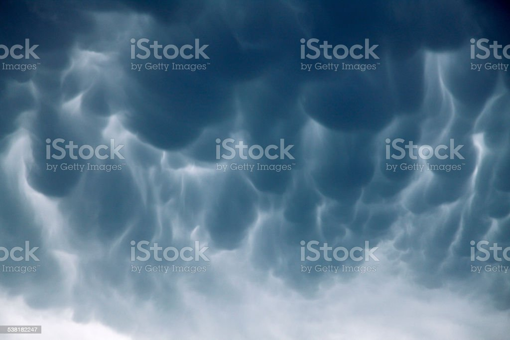Dramatic mammatus storm clouds stock photo