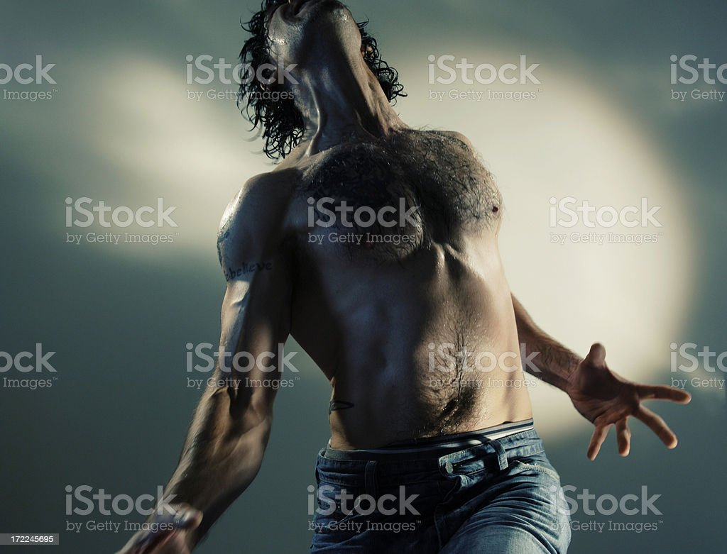 dramatic man series Semi-nude topless male in jeans and boxer shorts with dramatic cinematic lighting Abdominal Muscle Stock Photo
