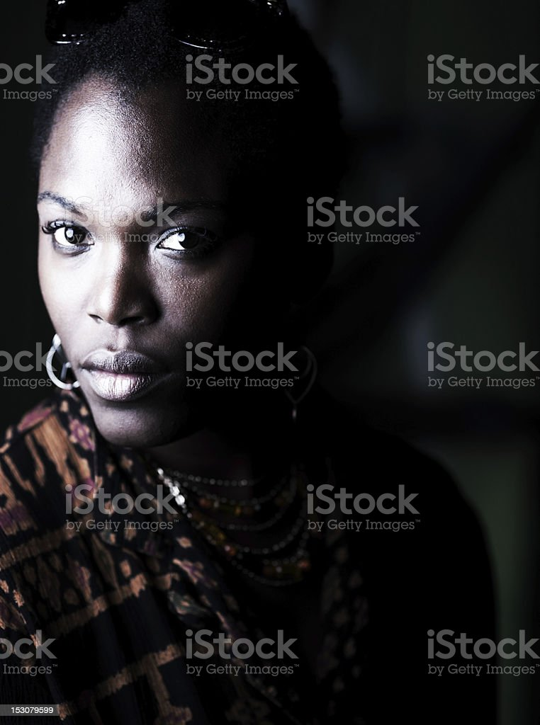 dramatic night time portrait of beautiful African American woman stock photo