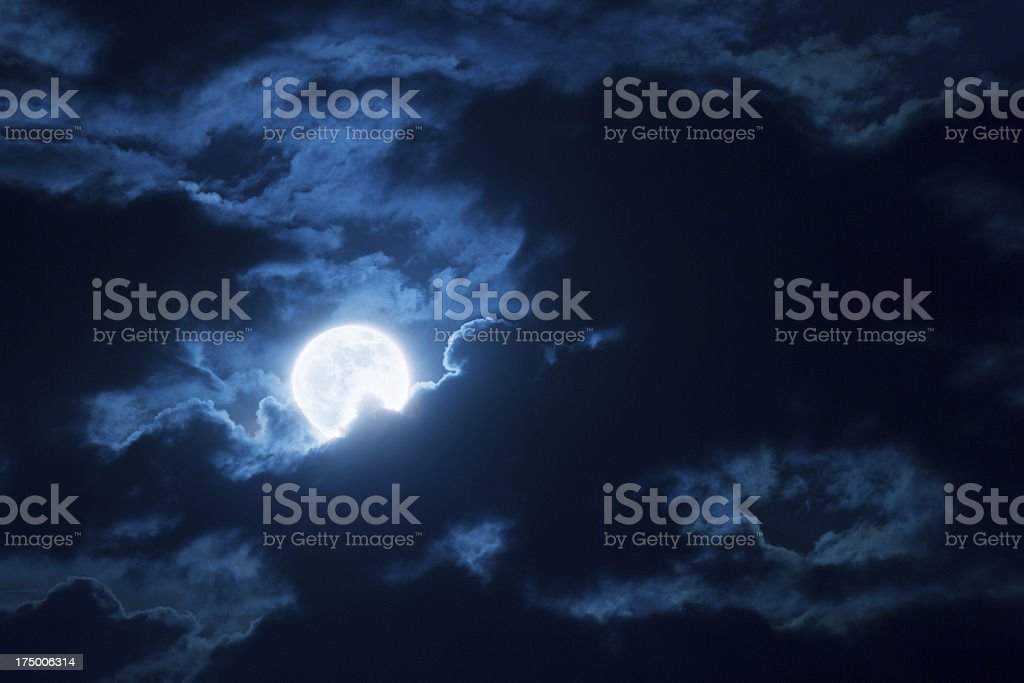 Dramatic Nighttime Clouds and Sky With Beautiful Full Blue Moon royalty-free stock photo