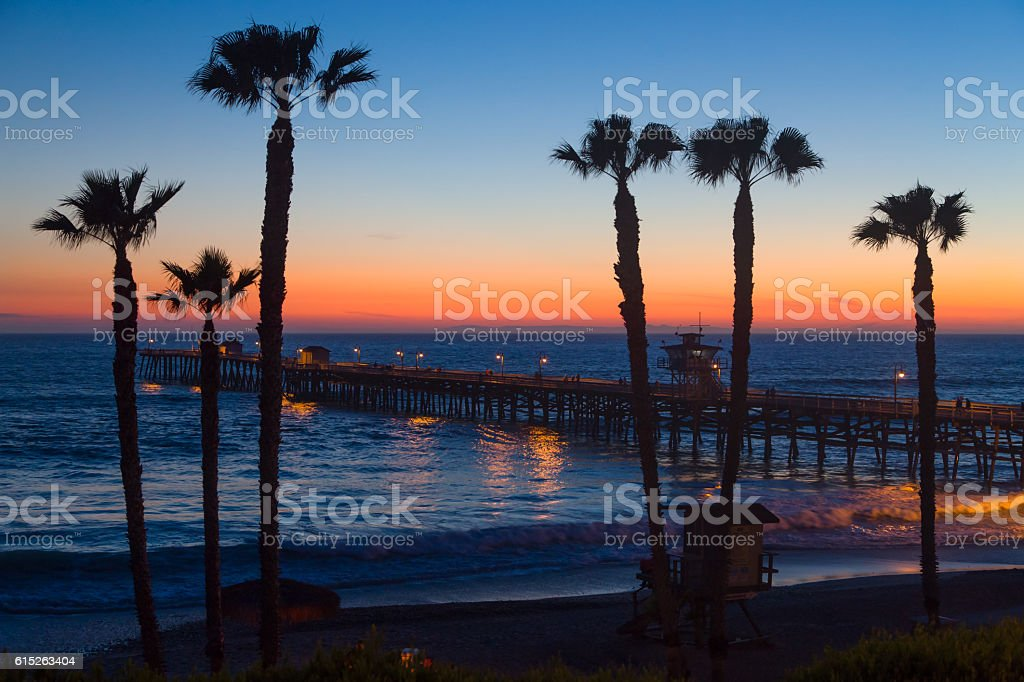 Dramatic Ocean Sunset at San Clemente Pier stock photo