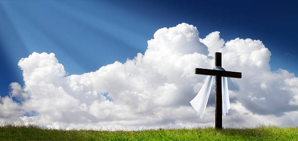 dramatic panorama easter sunday morning sunrise with cross on hill - cross stock photos and pictures