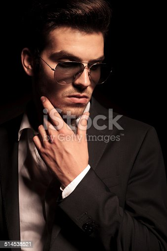 907934274 istock photo dramatic pensive young man 514538521