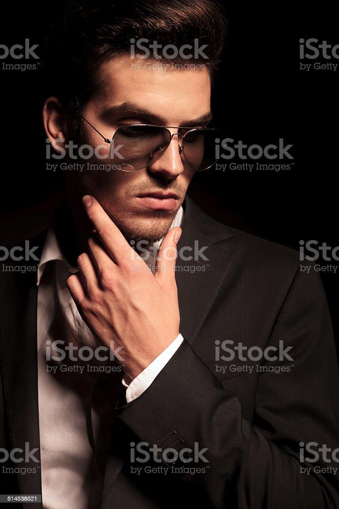 dramatic pensive young man stock photo