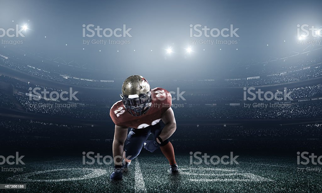 Dramatic picture of football player in stadium at night stock photo