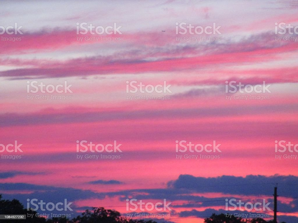 Dramatic Pink Sunset with Clouds stock photo
