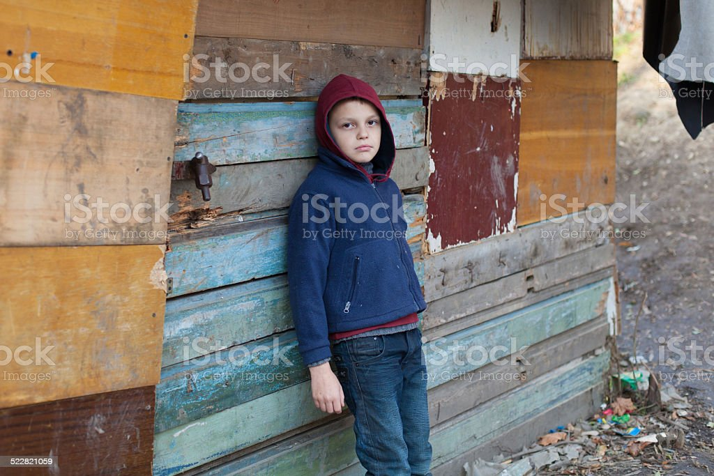 dramatic portrait of a little homeless boy stock photo