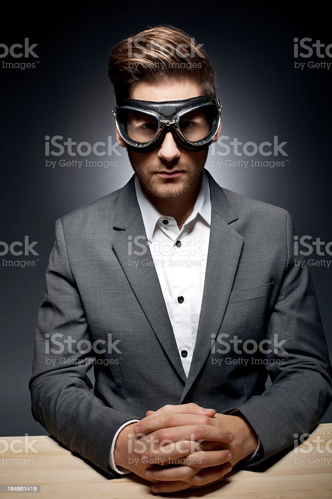 Dramatic Portrait of a Man with Goggles stock photo
