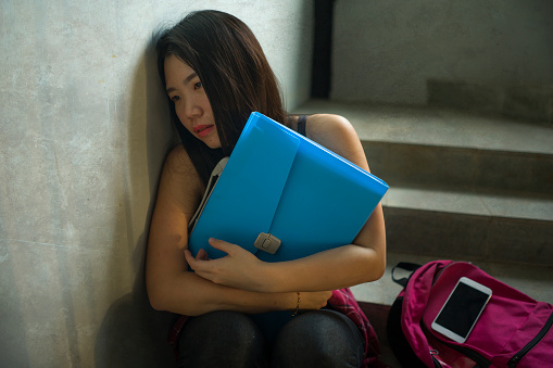 Dramatic Portrait Of Asian Female College Student Bullied ...