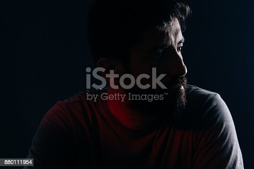 istock Dramatic portrait of bearded man. Concept of sadness, depression, alert 880111954