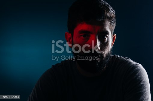 istock Dramatic portrait of bearded man. Concept of sadness, depression, alert 880112044
