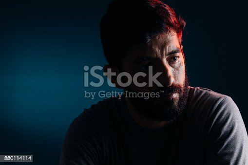 istock Dramatic portrait of bearded man. Concept of sadness, depression, alert 880114114