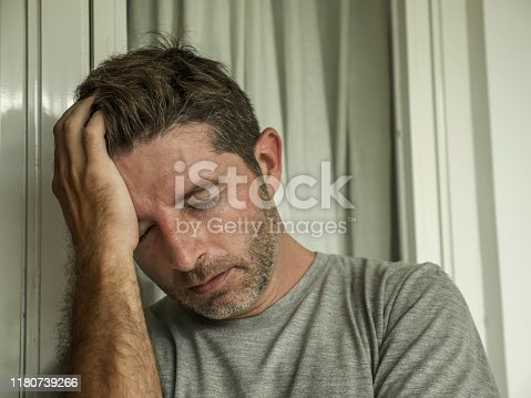 584608574 istock photo dramatic portrait of middle aged sad and depressed man in pain feeling stressed and frustrated suffering depression problem and anxiety crisis looking desperate and gloomy 1180739266
