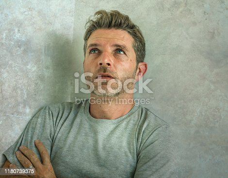 584608574 istock photo dramatic portrait of middle aged sad and depressed man in pain feeling stressed and frustrated suffering depression problem and anxiety crisis looking desperate and gloomy 1180739375