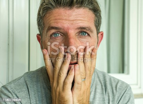 584608574 istock photo dramatic portrait of middle aged sad and depressed man in pain feeling stressed and frustrated suffering depression problem and anxiety crisis looking desperate and gloomy 1180739408